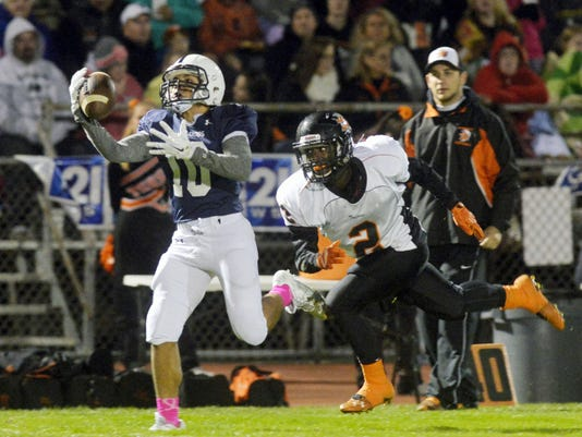 West York's Dante Dorm makes the catch against York Suburban's Dajour Henderson in the first half of a YAIAA football game on Oct. 16 at West York High School. York Suburban defeated West York, 23-22.