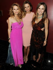Bethany Joy Galeotti, Shantel Van Santen and Sophia Bush pose at The CW's presentation of 'An Evening with One Tree Hill' in 2011.