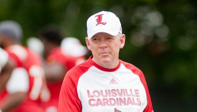 University of Louisville head football coach Bobby Petrino watches the team's practice on Saturday, Aug. 6, 2016.