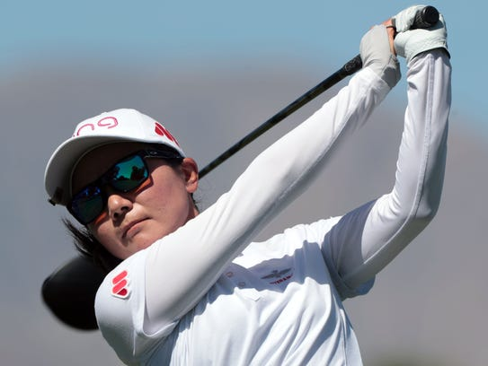 Ayako Uehara, of Japan, tees off on 9 during the first