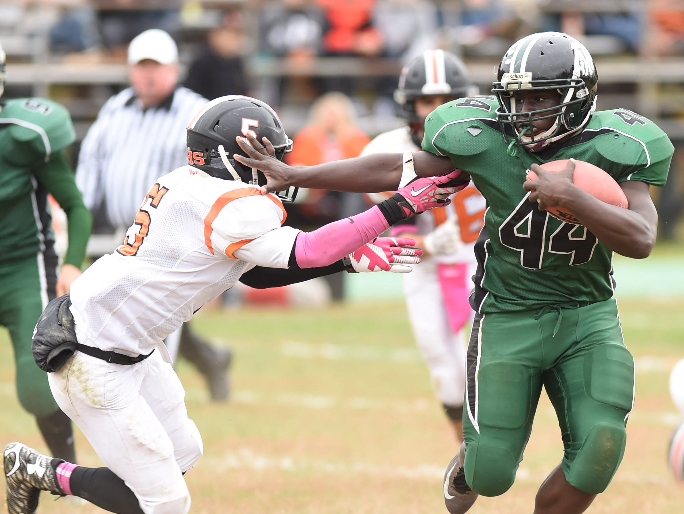 Spackenkill's Dhyquem Lewinson deflects Dover's Jaquon Futrell during Saturday's game in Poughkeepsie.