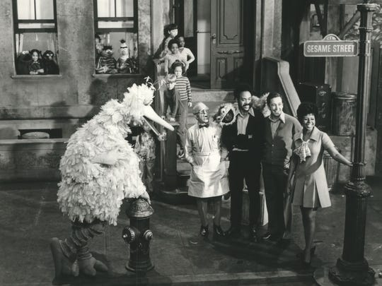 "The residents of ""Sesame Street"" in 1970 include (from left, foreground): Big Bird, Mr. Hooper; Gordon and Oscar the Grouch, Bob and Susan."
