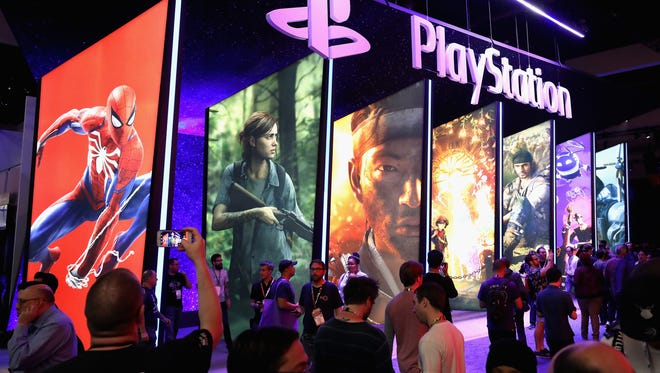 Game enthusiasts and industry personnel visit the Sony Playstation exhibit.