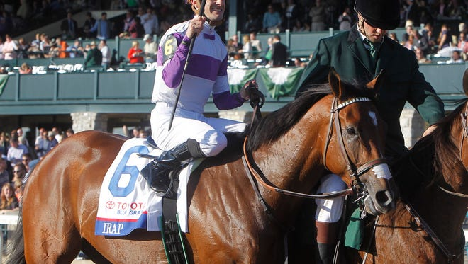 Jockey Julien Leparoux waves his whip celebrating his win aboard Reddam Racing's Irad in the grade 1 $1,000,000 Toyota Blue Grass Stakes at Keeneland Race Course in Lexington, Ky., Saturday, April 8, 2017.