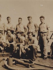 Bill Knapp of Des Moines on the deck of his Navy ship during World War II. He is the third from right in the back row.