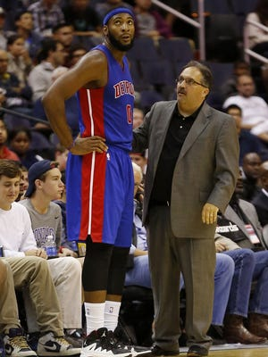 Detroit Pistons coach Stan Van Gundy, right, talks with center Andre Drummond (0) against the Washington Wizards.