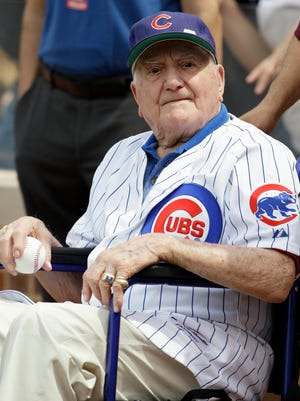FILE - In this June 7, 2014, file photo, former Chicago Cubs shortstop Lennie Merullo looks toward the field before throwing out a ceremonial first pitch before a baseball game between the Miami Marlins and the Cubs in Chicago. Merullo, the oldest former member of the Cubs and the last living person to play for them in the World Series, has died. He was 98. Cubs owner Tom Ricketts said in a statement Saturday, May 30, 2015, that Merullo died earlier in the day.