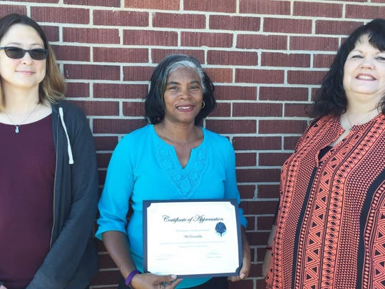 McDonalds, recognized from left are Shavon Williams; Stacey Linnette, McDonalds owner, and Sandra Austin, ACDSNB Director of Staff Development.