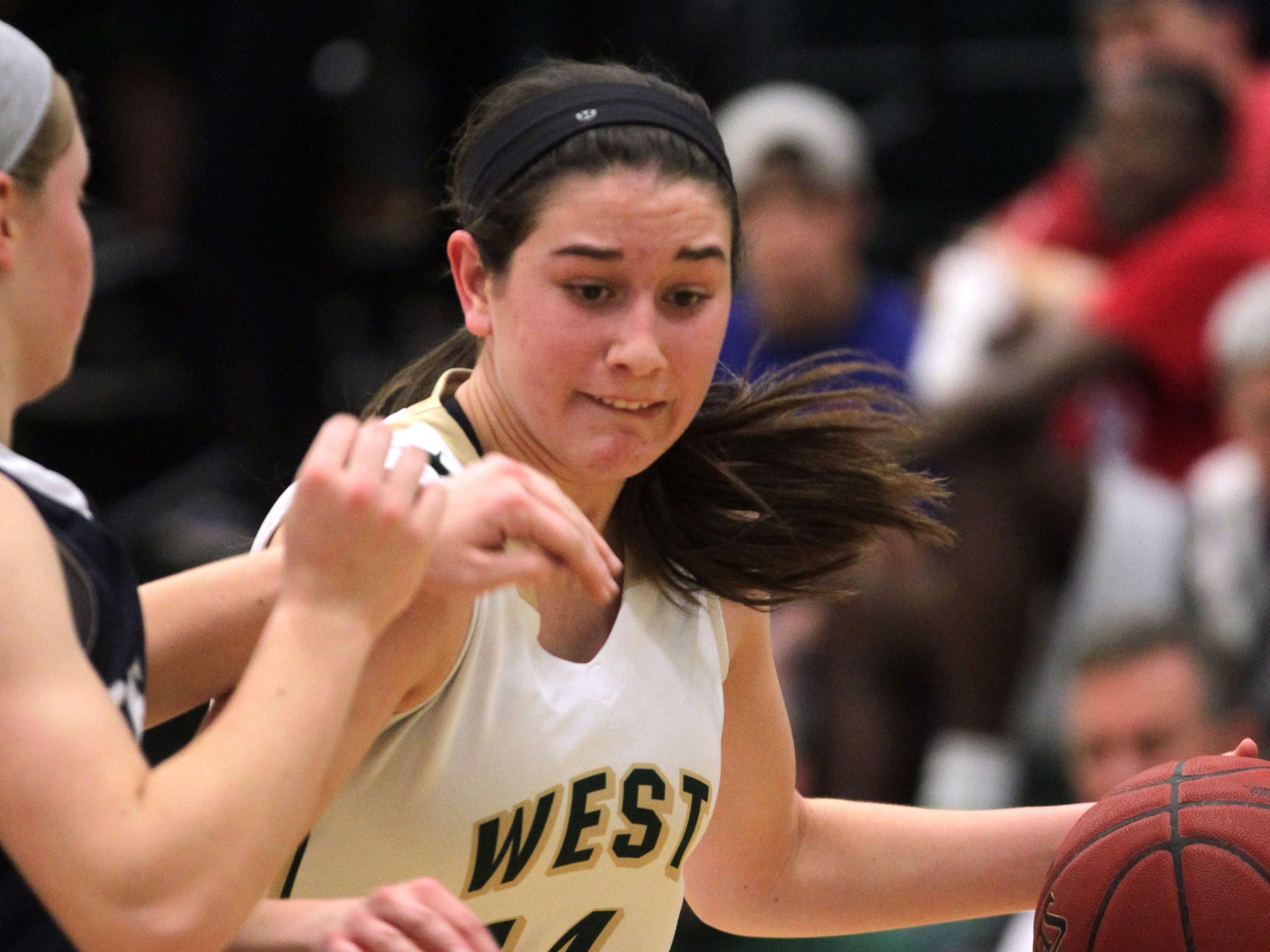 West High's Dani Craig drives to the hoop during the Women of Troy's Class 5A regional final against Pleasant Valley on Tuesday, Feb. 24, 2015. West High won, 45-27, to advance to the state tournament. David Scrivner / Iowa City Press-Citizen