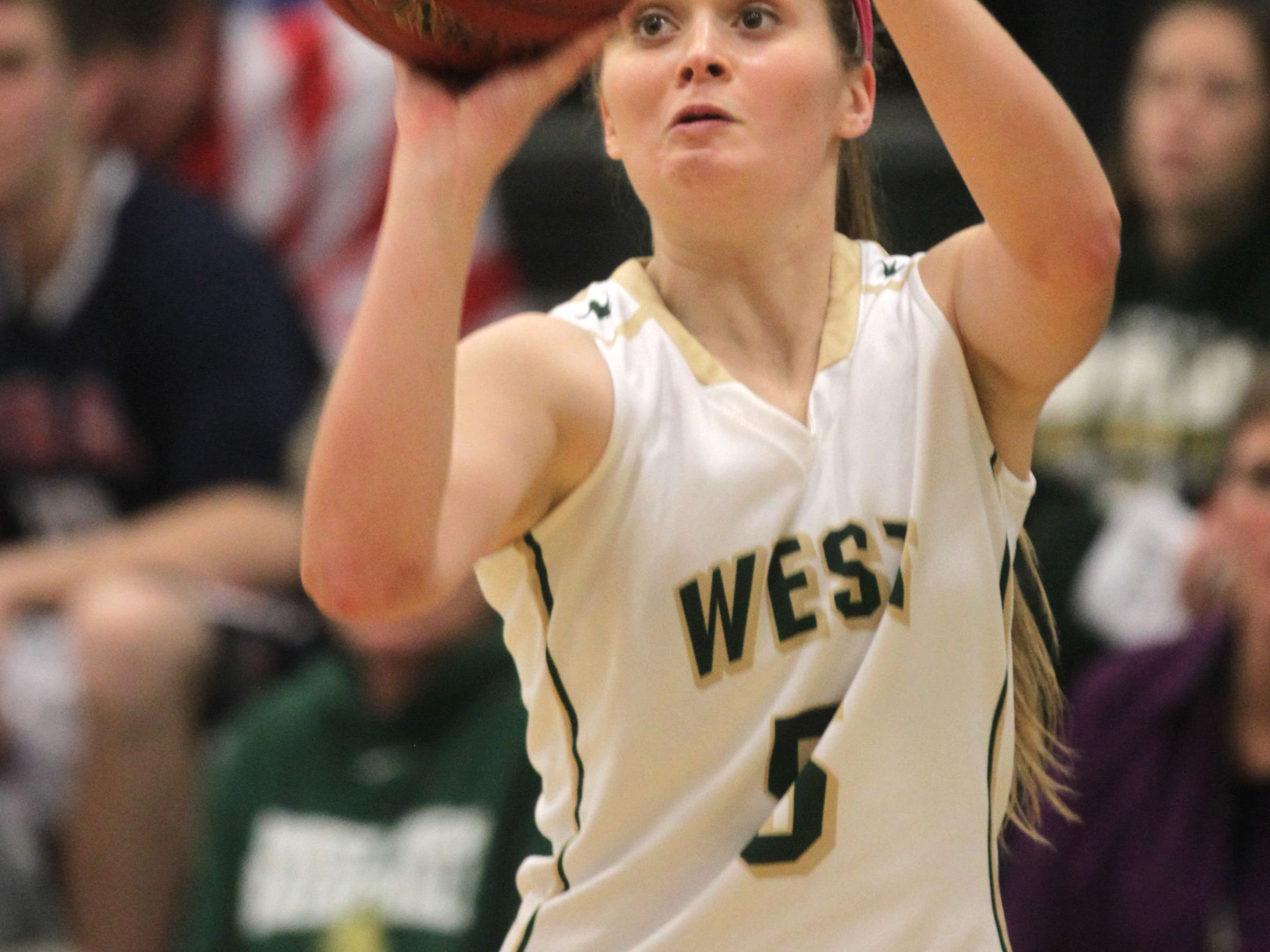 West High's Grace Tafolla takes a shot during the Women of Troy's Class 5A regional final against Pleasant Valley on Tuesday, Feb. 24, 2015. West High won, 45-27, to advance to the state tournament. David Scrivner / Iowa City Press-Citizen