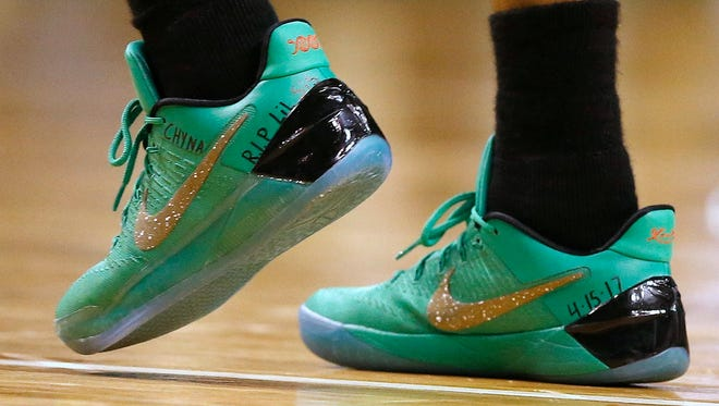 Boston Celtics' Isaiah Thomas wears a message on his shoes in memory of his sister Chyna during Sunday's playoff game against the Chicago Bulls in Boston.