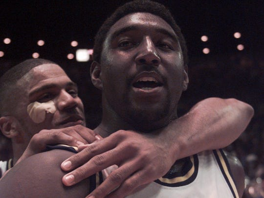 Michigan's Robert Traylor, front, and teammate Maurice