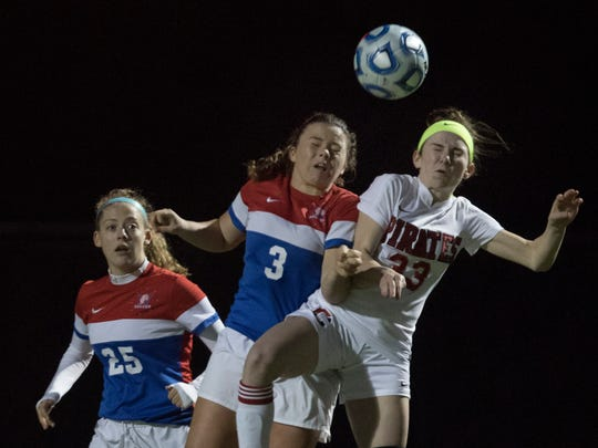 Wall's Maggie Wishart battles for a header against Cinnaminson's Emma Karch during first half action. Wall Girls Soccer vs Cinnaminson in NJSIAA Group II Semifinal in Pennington, NJ on November 14, 2017.