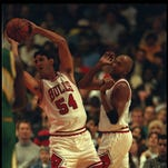 Oct. 21, 1995: Jack Haley  bends to find an open Chicago Bulls teammate at the United Center in Chicago.