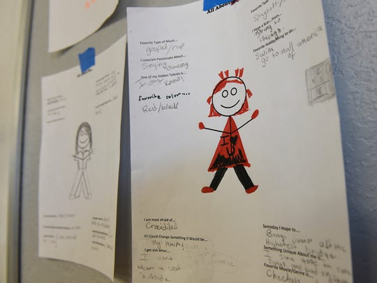 Worksheets completed by children are displayed on a wall Thursday, March 24, at the St. Cloud Salvation Army shelter.