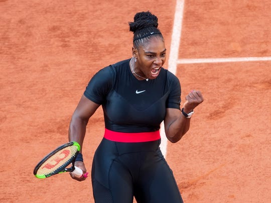 Serena Williams reacts during her match against Julia
