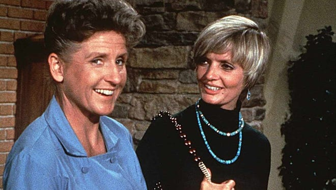 "Florence Henderson, right, is seen on the set of ""The Brady Bunch"" with Ann B. Davis, who portrayed Alice on the sitcom."