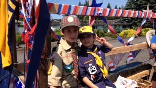 Hunter (left) and Connor Hoffman, members of Cub Scout Pack 122, received a generous donation from a mystery man during a fundraiser for their pack.