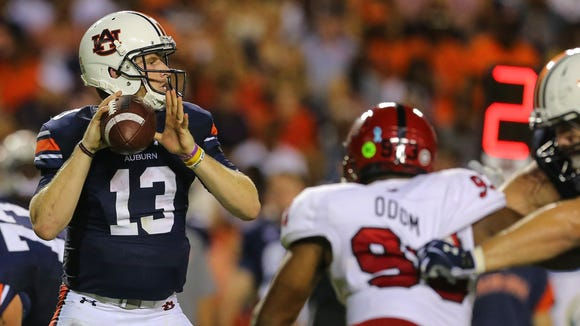 Auburn quarterback Sean White (13) throws a pass against Arkansas State during the first half of an NCAA college football game, Saturday, Sept. 10, 2016, in Auburn, Ala. (AP Photo/Butch Dill)