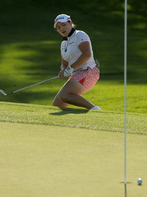 Ha Na Jang, of South Korea, watches as her chip slides by the hole on the ninth green during the first round of the LPGA Tour ANA Inspiration golf tournament at Mission Hills Country Club, Thursday, March 31, 2016 in Rancho Mirage, Calif. (AP Photo/Chris Carlson)
