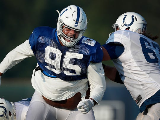 Indianapolis Colts defensive tackle Johnathan Hankins (95) spins around offensive tackle Jeremy Vujnovich (67)at their practice during preseason training camp Thursday, August 3, 2017, morning at the Colts complex on West 56th Street.