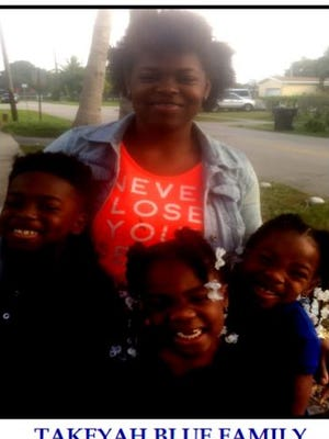 Takeyah Blue, in back, with her children, from left, Najeah, Ymani, and Paris.