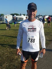 """Wallace Brown, a seasoned triathlon runner, did the EAA AirVenture Runway 5K as a """"fun run,"""" and finished 41 overall."""