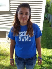 Aqua Pedraza, 15, poses for a photo in front of her Wausau house on July 9, 2016.