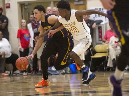 Montverde Academy's Ben Simmons is guarded by Wheeler's Darius Perry in the championship game of the 42nd Annual Culligan City of Palms Classic on Tuesday, December 23, 2014 at Bishop Verot High School in Fort Myers.