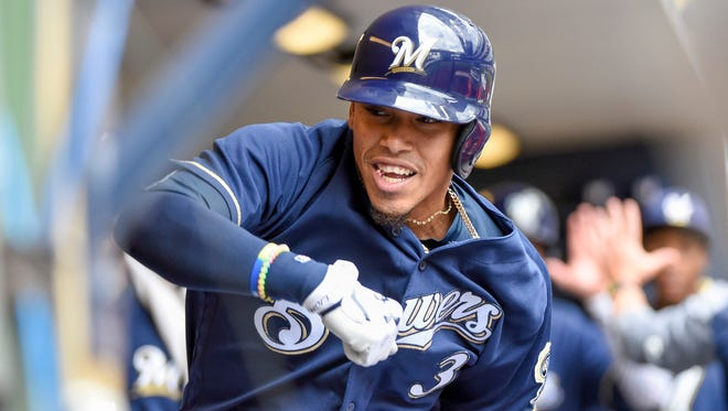 Brewers shortstop Orlando Arcia reacts in the dugout after hitting a two-run homer in the third inning against the Reds Wednesday afternoon at Miller Park.