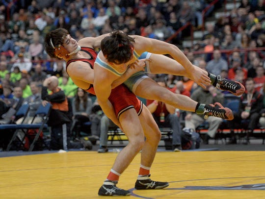 Hilton's Yianni Diakomihalis, left, wrestles against