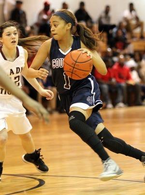St. Thomas More's Megan Abrams (1) drives toward the basket in a girls high school basketball game against Breaux Bridge Tuesday at Breaux Bridge High School.