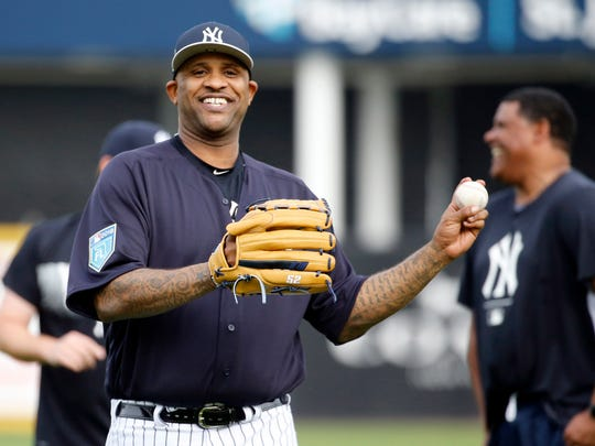 New York Yankees starting pitcher CC Sabathia (52) smile as he works out as pitchers and catchers arrive for spring training at George M. Steinbrenner Field in Tampa, Fla. on Feb. 13, 2018.