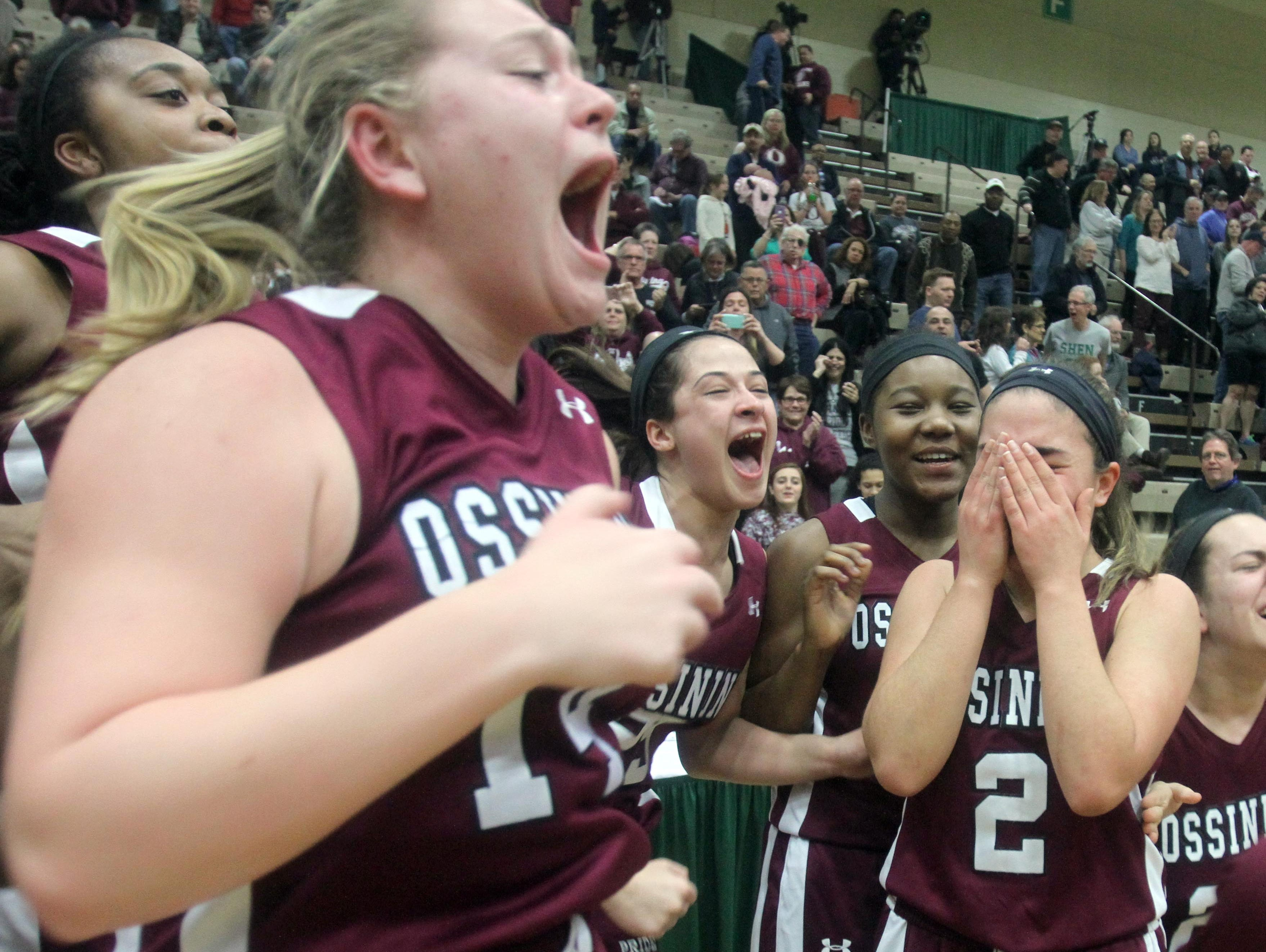 Ossining celebrates after defeating Shenendehowa 69-66 to win the New York State Class AA championship at Hudson Valley Community College in Troy March 12, 2016.