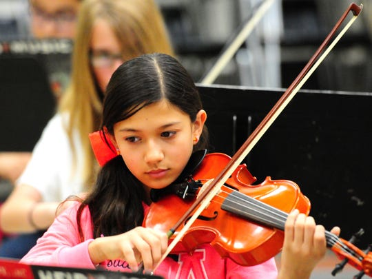 Naomi Sawabe plays violin at orchestra rehearsal during summer music camp at the University of Wisconsin-Green Bay.