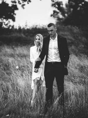 Olivia Harlan and Sam Dekker pose for their engagement photos last summer. The pair will be married in July in Door County. In lieu of wedding gifts the pair are asking guests and fans to donate to the Children's Cancer Family Foundation.