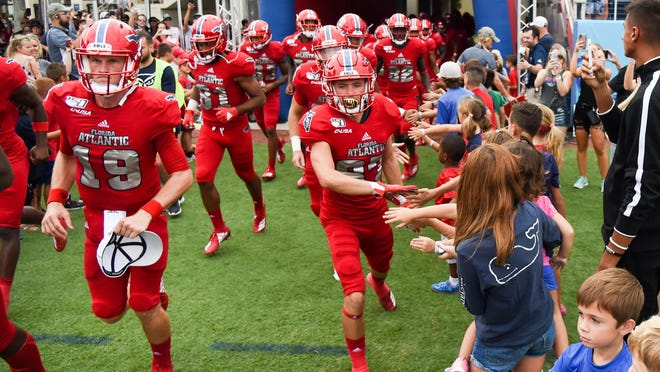Florida Atlantic wide receiver Dante Cousart (87) and teammates take the field before a 28-13 victory at FAU Stadium on Oct. 12, 2019.