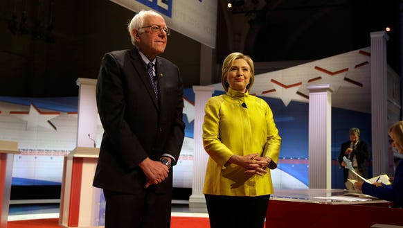 Bernie Sanders and Hillary Clinton take the stage before