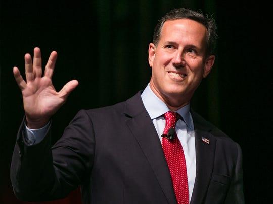 Senator Rick Santorum is greeted before speaking with Frank Luntz during the Family Leadership Summit in Ames on Saturday, July 18, 2015.