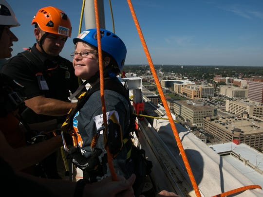 Special Olympic athlete Angela Oberlander, prepares to rappel down the side of the Financial Center during the Over the Edge for Special Olympics fundraiser in downtown Des Moines on Wednesday, September 16, 2015.
