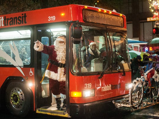 Santa Claus waves to the crowd after arriving on a RabbitTransit bus during York City's Light Up Night on First Friday in 2014.