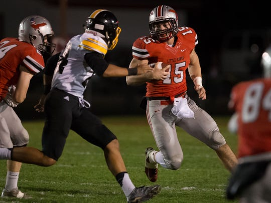 City High quarterback Nate Wieland (15) runs in the second quarter at City High on Friday, October 14, 2016.