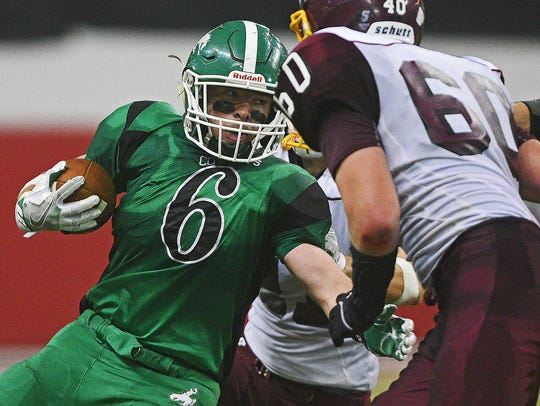 Colome's Jackson Kinzer, then a sophomore, carries the ball during the 2016 Class 9B championship game against Langford Area.