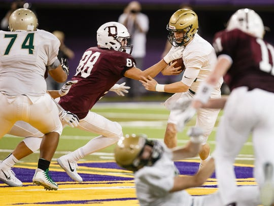 Iowa City, West's Evan Flitz (10) is tackled by Dowling