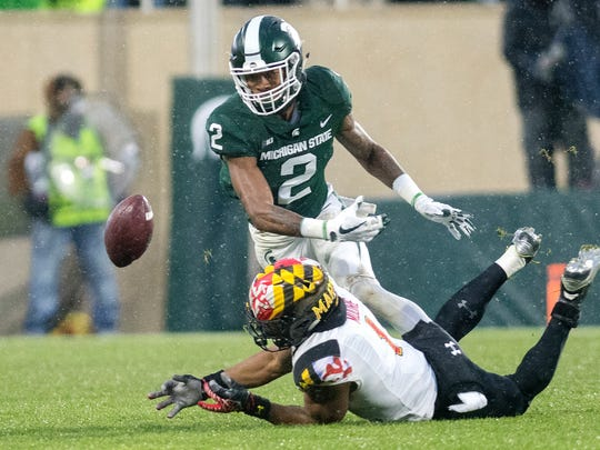 Michigan State's Justin Layne breaks up a pass intended