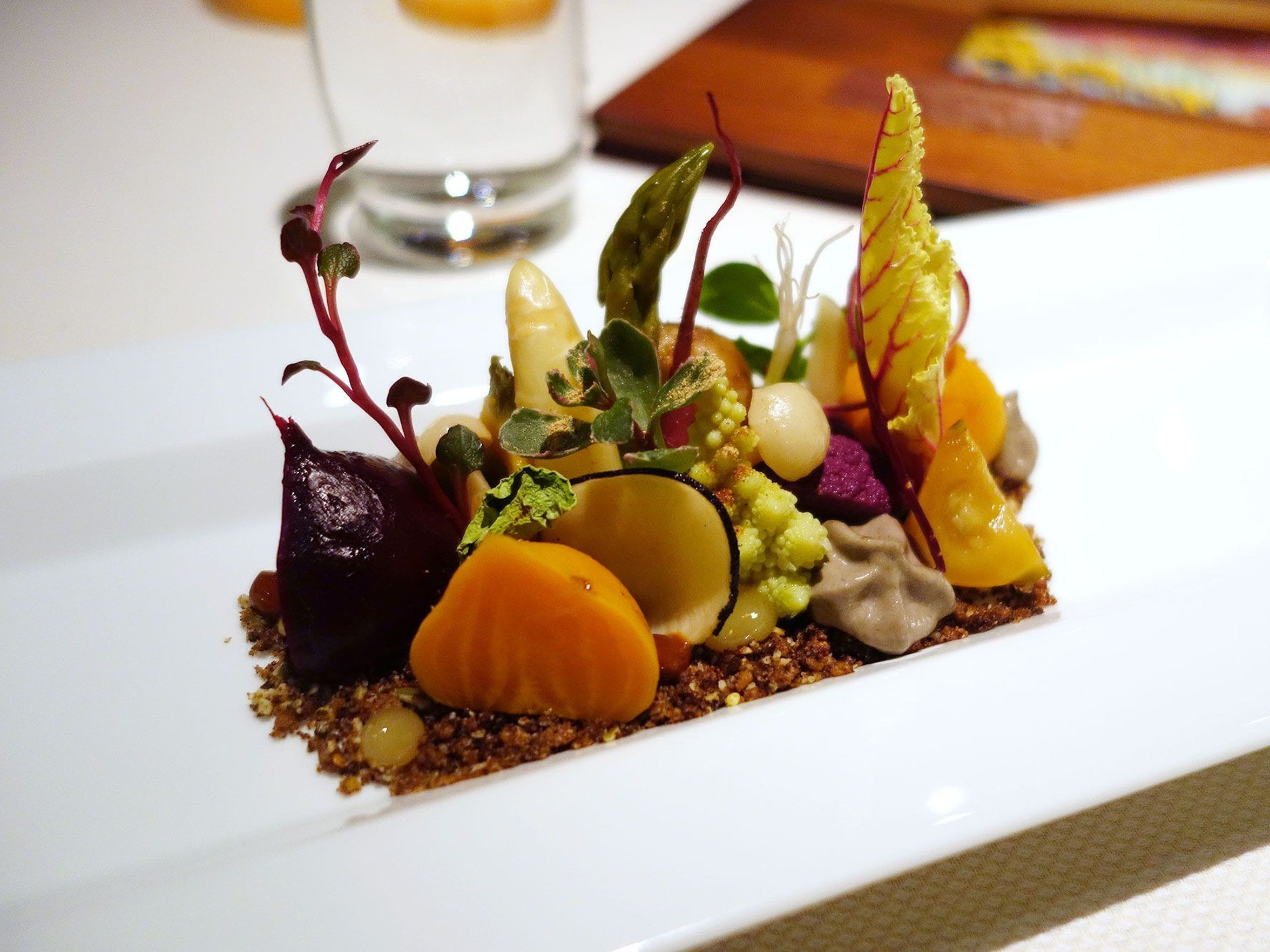 "Preserved Garden at Kai (pictured) is a whimsical little number, a textural explosion of pickled root vegetables, earthy mousse, chanterelle mushrooms and dried cactus pads, all planted in a crunchy pile of dried rye ""soil."""