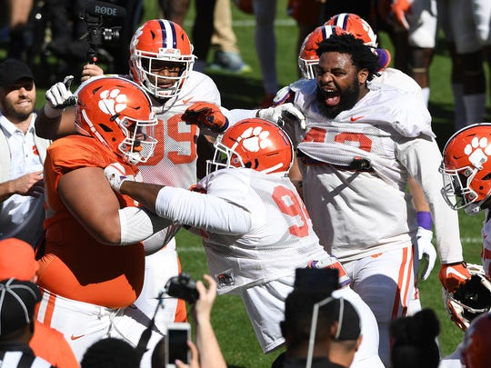 Clemson offensive lineman Jackson Carman (79) and defensive lineman Josh Belk (94) during the team's practice on Wednesday, April 4, 2018 at Clemson's Memorial Stadium.