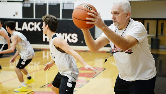 North Buncombe basketball coach Chuck Robinson runs a drill with his team during practice Nov. 24.