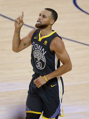 Stephen Curry reacts after scoring a basket during Game 2 of the 2018 NBA Finals.