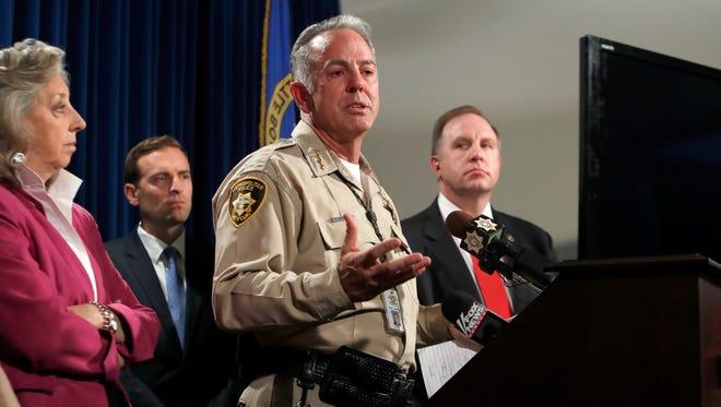 Clark County Sheriff Joe Lombardo, center, responds to a question during a media briefing at the Las Vegas Metro Police headquarters in Las Vegas, Tuesday, Oct. 3, 2017. (Steve Marcus/Las Vegas Sun via AP)